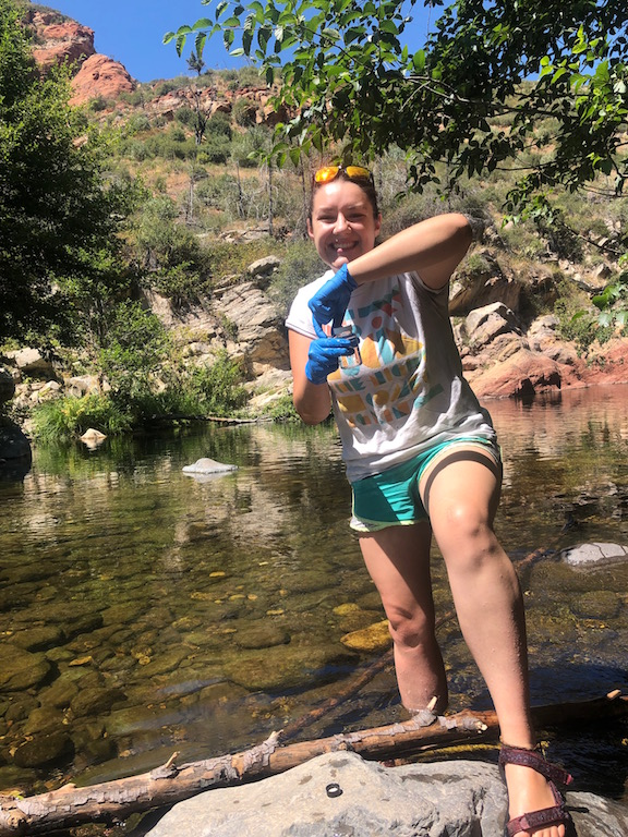 Oak Creek Ambassador takes water quality sample